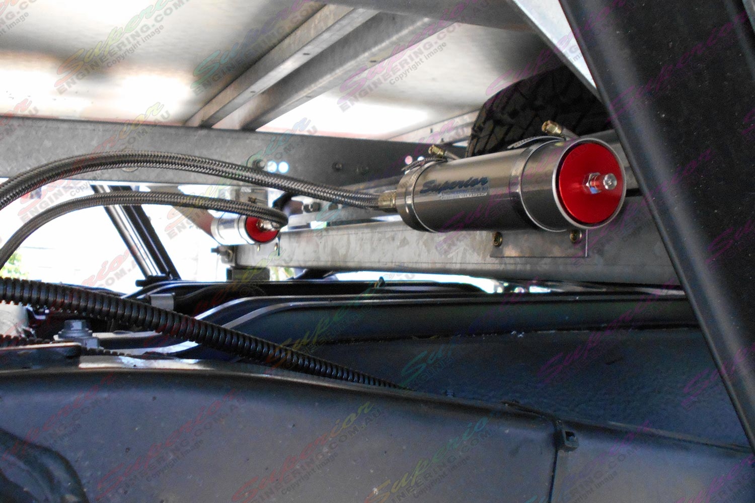 Rear AmadaXtreme Remote Reservior Shocks mounted to vehicle