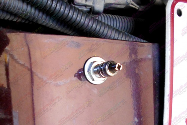 Close-up view of the air hose valve mounted to the rear of the Hilux
