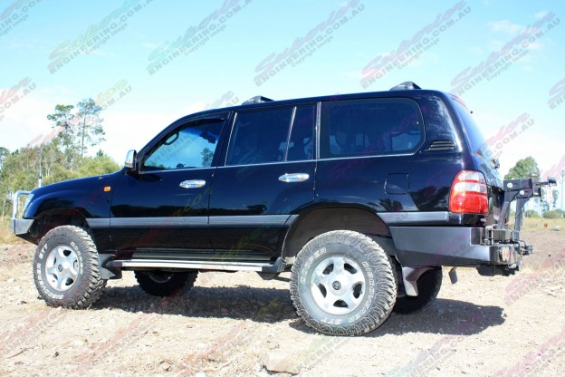 "Left side view of a Toyota Landcruiser 100 Series fitted with 2"" inch airbag man lift kit"