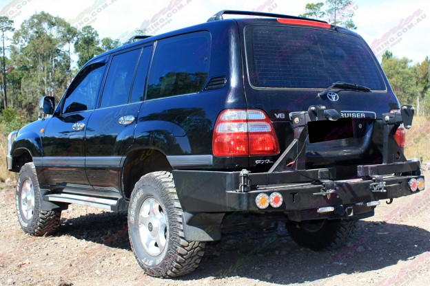 "Rear end view of a Toyota Landcruiser 100 Series IFS fitted with 2"" inch lift kit with Airbag Man coil helpers"