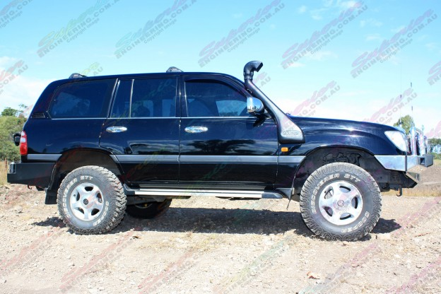 "Right side view of a Toyota Landcruiser 100 Series on dirt track fitted with 2"" inch lift kit from Superior Engineering"