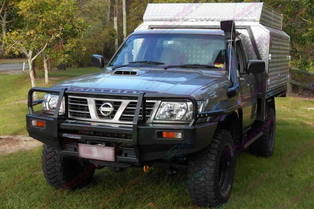 Front angle view of Nissan Patrol GU Ute fitted with a 3 Inch Profender Airbag Lift Kit