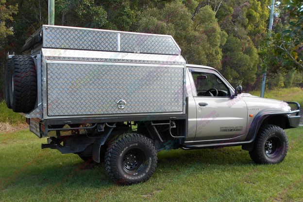 Side profile of Nissan Patrol GU Work Ute after being fitted out with a 3 Inch Profender Airbag Lift Kit