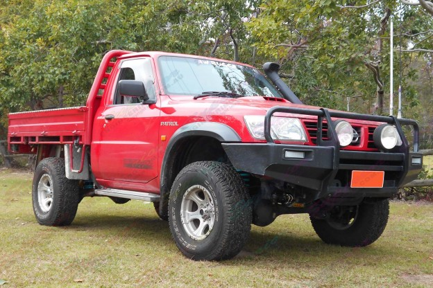 Front left side view of a Nissan Patrol GU Ute after being fitted with a 2 Inch Bilstein and Airbag Man Airbag Lift Kit
