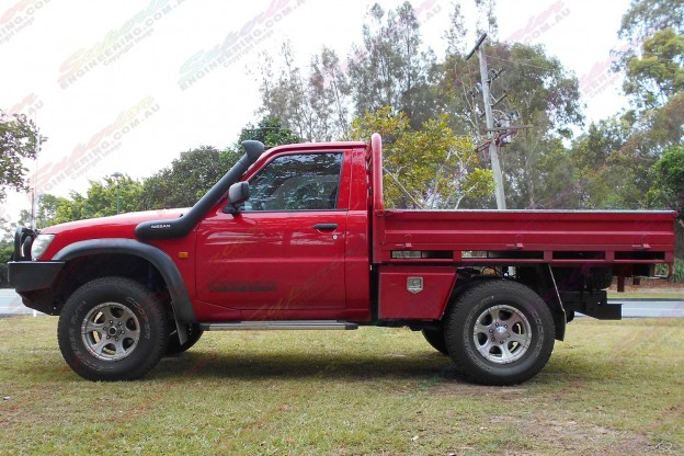 A Red Nissan Patrol GU Cab Chassis after being fitted with a 2 Inch Bilstein and Airbag Man Airbag Lift Kit