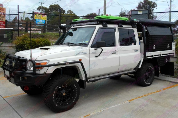 Left side view of a Toyota Landcruiser 79 Series with some AirBag Man Leaf Spring Helpers