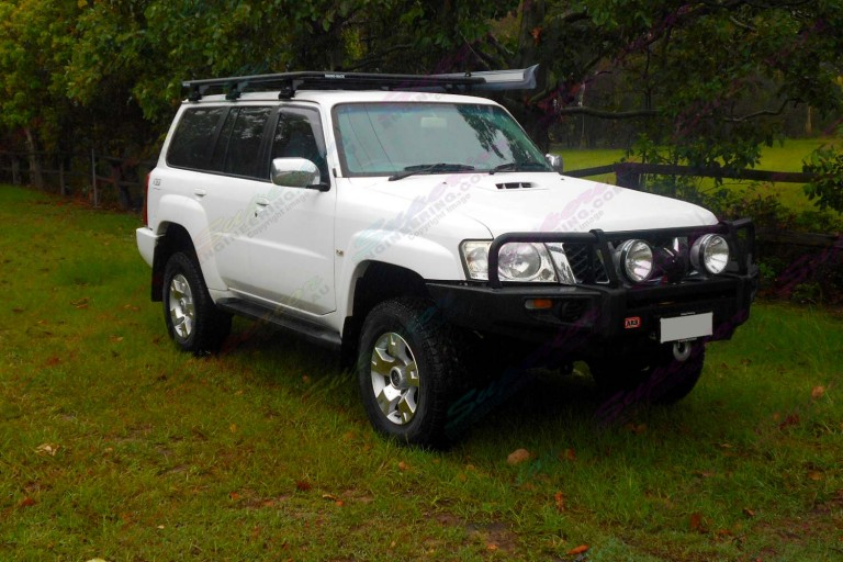 Right side view of a white Nissan Patrol GU Wagon fitted with a 2 inch Airbag Man Coil Helper Kit and Superior lift kit