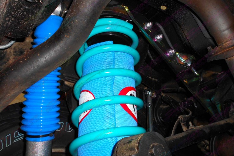 Closeup view of the Airbag Man airbags, Superior coils and shocks