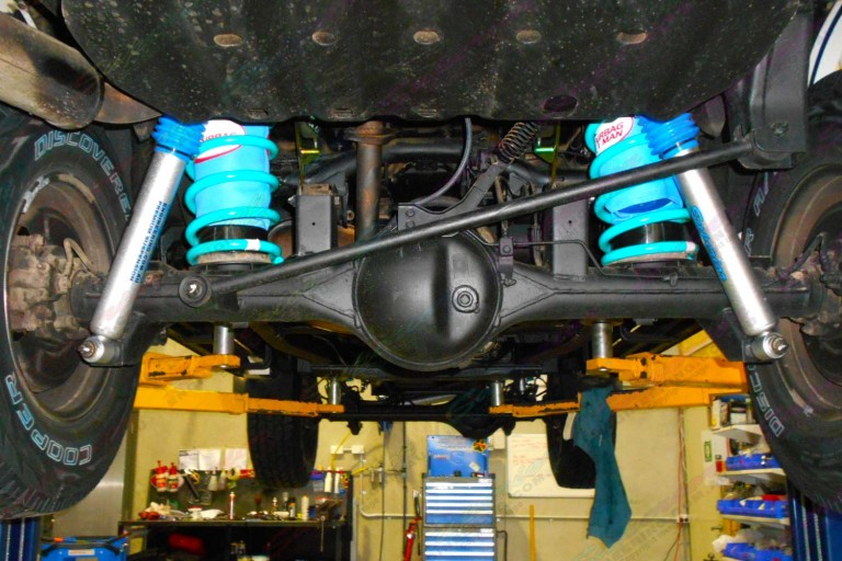 Underside view of the Nissan Patrol fitted with airbags, coils and nitro gas shocks