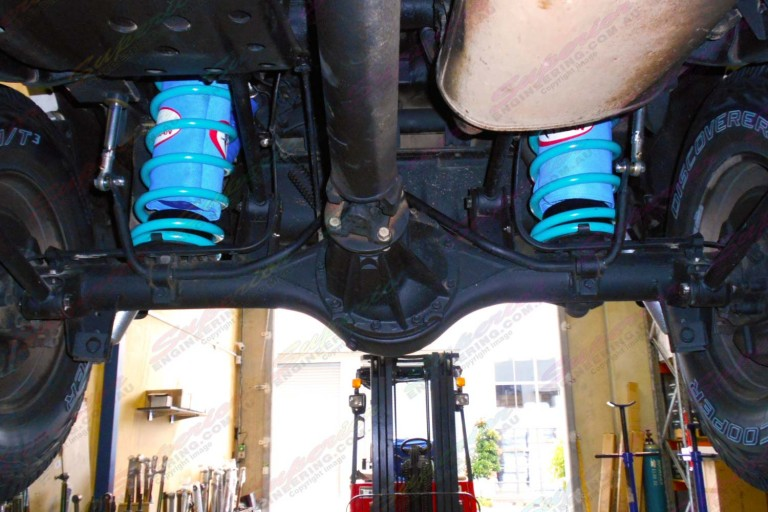 Underside view of the Nissan Patrol fitted with airbags, coils and swaybar extensions