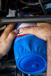 Mechanic fitting the airbag helper into the Nissan Navara NP300 rear coil spring