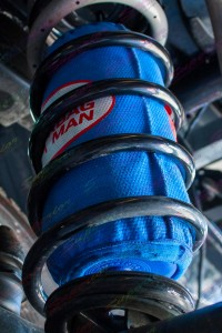 Another closeup view of a single airbag man coil helper and kevlar protection bag inside some black superior heavy duty coil springs
