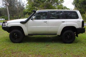 Left side view of a white Nissan GU Patrol Wagon fitted with a 3 inch Airbag Man suspension kit