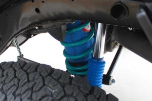 Closeup view of a single Airbag Man airbag, Dobinsons coil spring and Superior remote reservoir shock fitted to the Nissan Patrol