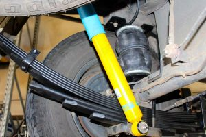 Closeup view of a single heavy duty airbag (fitted between the leaf spring and chassis), Bilstein shock absorber and EFS leaf spring fitted to the Holden Colorado