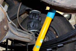 Closeup view of a single heavy duty airbag, Bilstein shock absorber and EFS leaf spring fitted to the rear of the Holden Colorado four wheel drive