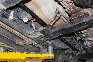 Closeup view of a single heavy duty EFS torsion bar fitted to the underside of the Holden Colorado four wheel drive