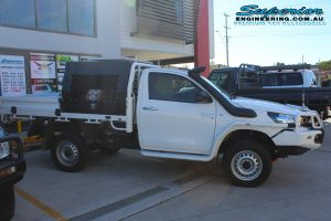Right side view of a Toyota Hilux Revo (single cab) fitted with a 2 inch Airbag Man leaf spring helper kit and Dual air control kit