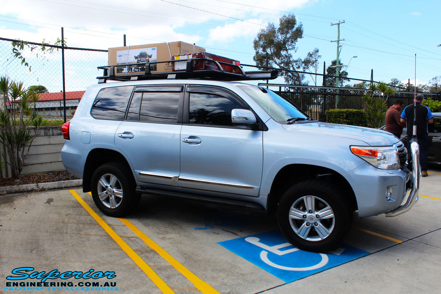 Toyota 200 Series Landcruiser Wagon Blue 4x4 Airbags Land Cruiser Lift Kit Right Side View Of A After Fitment Superior Remote
